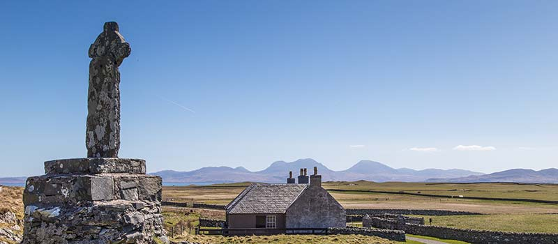 Cross at Oronsay Priory with View to Paps of Jura